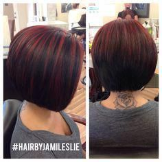 An adorable stacked a-line bob with red highlights! Hair by Jami Leslie Tiger Tail Salon-Carlsbad CA #hairbyjamileslie #tigertailsalon #shorthair #redbobhair