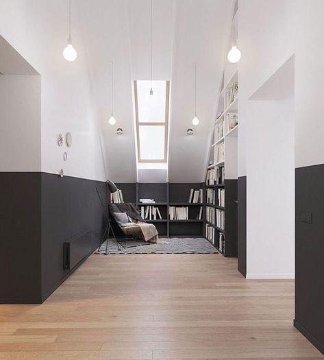 La peinture noir mat est appliqué non seulement sur la moitié de tous les murs de la pièce, mais aussi sur la moitié du mobilier (bibliothèques) ce qui crée une coupure et un contraste horizontal