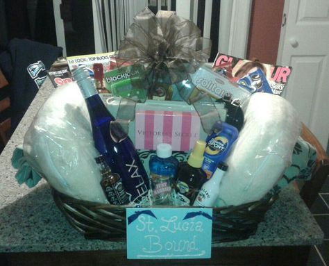 """The Honeymoon basket I made for my best friends bridal shower! Complete with: Towels, neck pillows, magazines (his and hers), snacks, a photo album, sunscreen/aloe, a VS gift card, lots of airplane bottles and a """"just married"""" shot glass!!"""