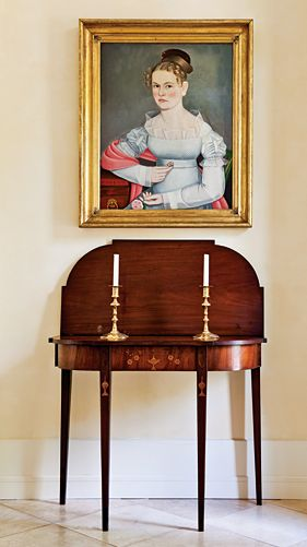 Some of the pieces of most importance to the collectors are displayed in the foyer. A Federal card table, probably made in or near Providence, R.I, circa 1800, is one of the finest examples of the form. Above it is a portrait of Kate Elting, painted in New Paltz, New York, probably in 1824. The sitter's white dress shows the artist's ability to adroitly picture transparent fabric. Kate leans on the edge of a table that is still in the Elting family house in New Paltz, now owned by the ...
