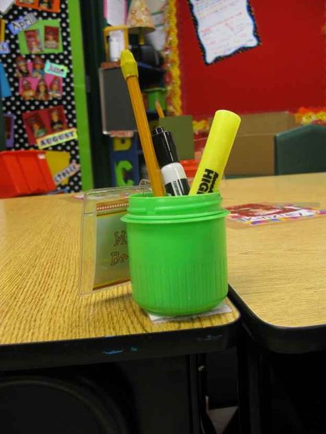 Use detergent caps and strips of velcro to keep pencils in place on desks. | 35 Money-Saving DIYs For Teachers On A Budget