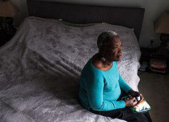 Thoughtful Senior Woman Sitting On Bed Affiliate Senior