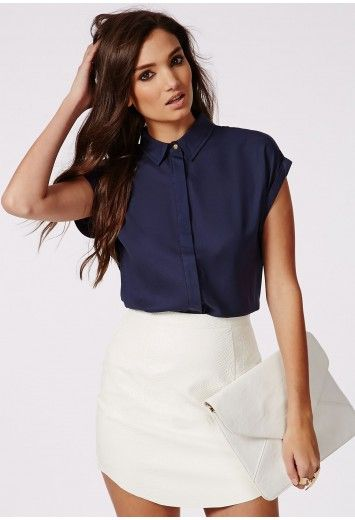 Embrace your inner chic and style it out in this short sleeve navy shirt. The concealed button front gives a feminine twist to the shirt finishing with a classic pointed collar and gold button - for a effortless look, style with leather tro...