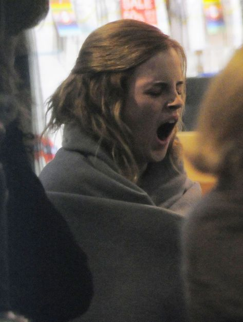 Emma Watson yawning on the set of Harry Potter and the Deathly Hallows.