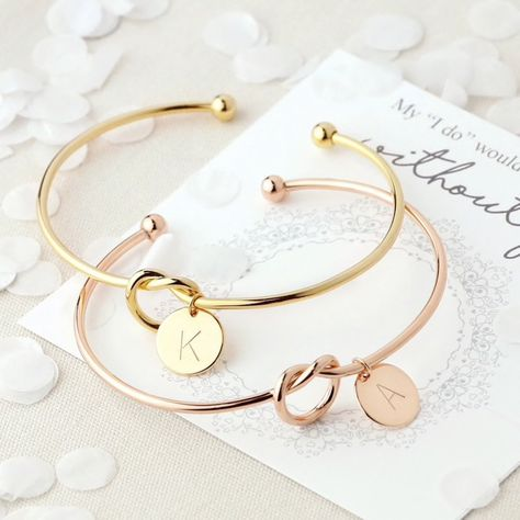 This is the Original Initial Knot Bracelet. We are the original manufacturers of this bracelet. It is designed with durability, adjustability and quality in mind. The base material is 100% tarnish-free stainless steel coated in 18kt gold in the rose and gold options. This bracelet is a perfect combination of affordability and quality. This piece is the perfect everyday item to add to your jewelry wardrobe and beautifully compliments our Knot Necklace. With your choice of initial and color, you w