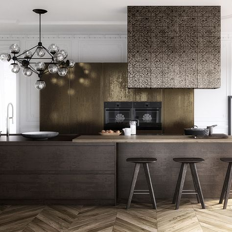 From warm copper to burnished brass, metal surfaces are a big trend for Take the look to new levels by combining different finishes. This 'Parisian' kitchen by Krieder features units coated with a mottled gold metallic lacquer and a porcelain workto