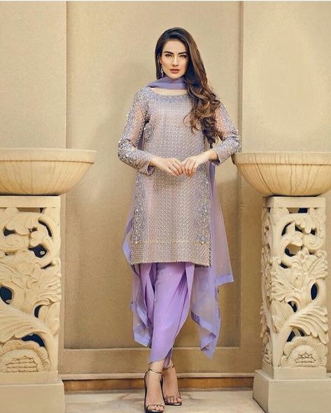 Tulip Pants suits became a trendy and fashion style now a day, which is suitable for every young girl and women as well. These tulip salwar kameez designs are look like a funky and very unique but no doubt its beautiful design among other design.