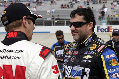 Tony Stewart and Greg Biffle in conversation before the start of the FedEx 400 at Dover International Speedway. View more photos from Dover here: http://www.stewarthaasracing.com/media/gallery/index.php