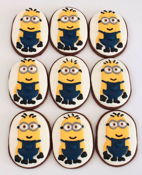 Minion Biscuits by Miss Biscuit, Melbourne, Victoria, Australia. You'll find this Cake Appreciation Society Member in our Directory at www.cakeappreciationsociety.com
