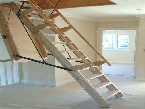 An Attic Ladder Is A Retracting Staircase That Pulls Down From The Ceiling To Give Accessibility To Attic Space Attic Renovation Tiny House Stairs Attic Ladder