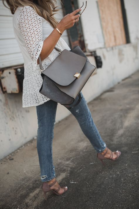 Always a fan of eyelet! Like the look of the eyelet tunic with jeans and strappy Steve Madden heels.