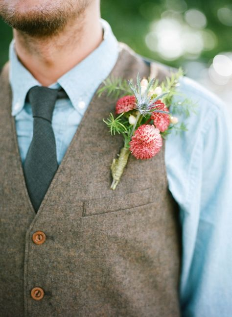 vest and tie groom look with pop of red boutonniere #groom #farmwedding #weddingchicks http://www.weddingchicks.com/2014/03/13/homespun-antique-farm-wedding/