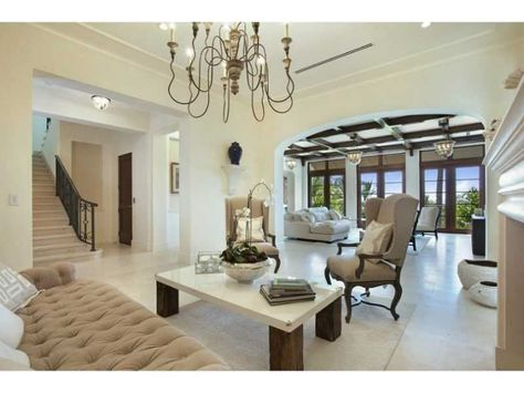 This formal sitting room is lavish and extraordinary. The neutral color scheme adds to the beauty.The custom chandelier acts as the centerpiece of the room. Miami Beach, FL Coldwell Banker Residential Real Estate
