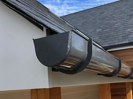 Seamless Guttering Artisan Roofing Are Specialist Manufacturers Of Seamless Aluminium Guttering In Surrey Berkshire And London Aluminium Seamless Surrey