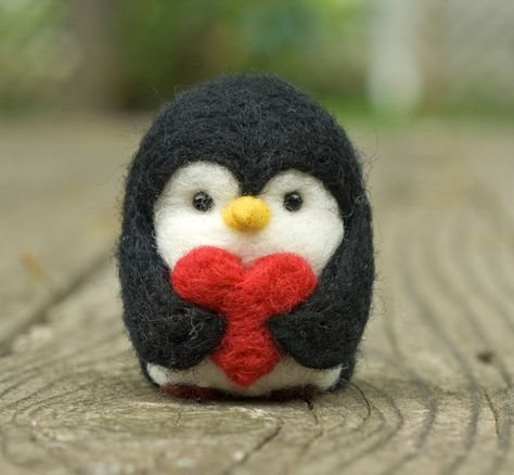 What a cute idea! Penguins don't just give special pebbles to their loves. This needle felted penguin offers a valentine heart  By scratchcraft on Etsy.