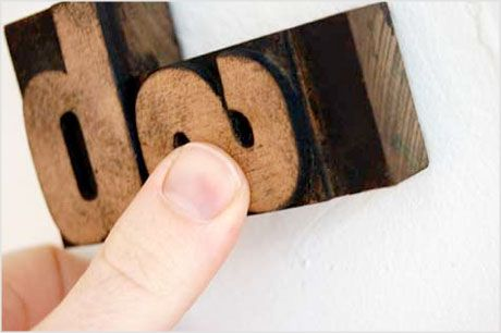 This little project involves attaching letterpress wood blocks to a wall in a design...COOL!
