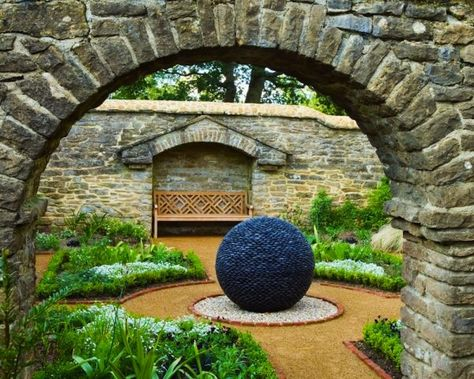 Perfectly symmetrical spheres made from hundreds of river stones created by David Harber