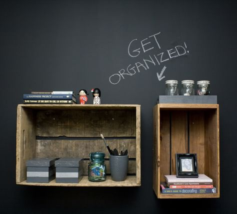 Love the look of the wooden crates against the chalkboard-painted wall.  This organization and colour system would definitely motivate me to keep my life in order!