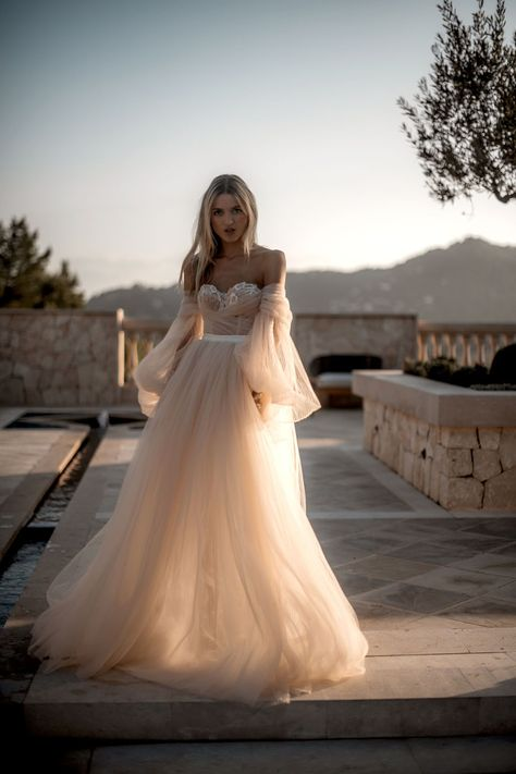 She's the kind of bride you want to be - embrace the uniqueness and elegance of ourdramatic #Bellina ballerina ballgown made of pleated silk tulle in shades of ivory and blush.  Photo: byTali Photography