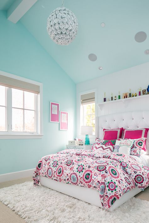 Turquoise Bedroom. bright bedroom carpet girls bedroom mint walls mirrored drawers pink bedding prints and patterns roman shades teal teen girls bedroom turquoise lamp vaulted ceiling white bed white headboard