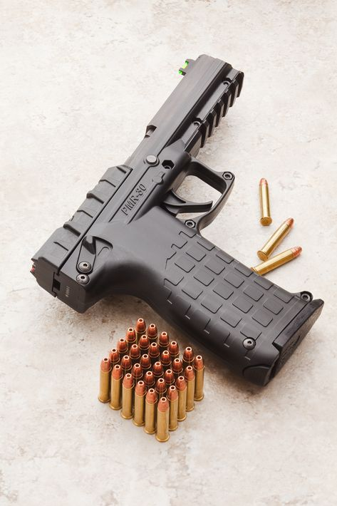 Kel-Tec PMR-30 .22 Magnum emergency pistol. 19oz loaded. Magazine holds 30 rounds. This with two spare mags in an emergency bag.