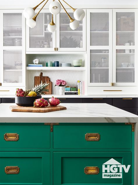 This otherwise neutral midcentury modern kitchen boasts a stunning marble-topped kitchen island painted emerald. See more on HGTV.com.