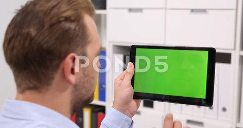 Business Man Using Digital Tablet In Corporate Office Green Screen
