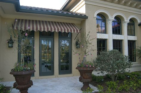 Mediterranean Style Home With A Stucco Home Exterior Rounded Windows That Give It The Castle Scene And High End Finish Siding Cost Stucco Homes