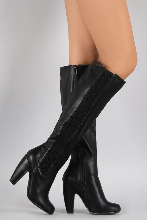 These chunky high heel boots feature a side elastic gore and an inner adjustable side zipper.