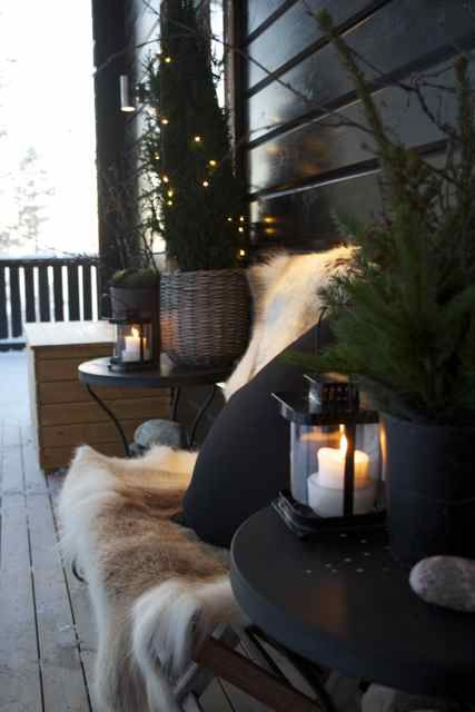 Reindeer hide as a seat cover on the balcony - love the spruces and candles