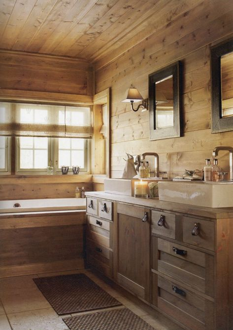 The bathroom is in the same rustic style as the rest of the cabin