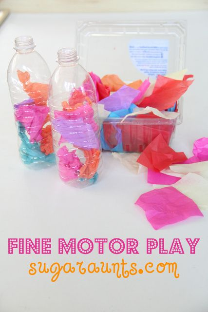 Tissue Paper and Empty plastic bottles: play plus fine motor strengthening, tripod grasp, defining arches of the hand, bilateral hand coordination, eye-hand coordination, colors, and FUN! By #TheSugarAunts