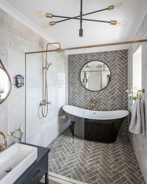 Extravagant master bathroom - complete with freestanding tub and herringbone tile wet room.