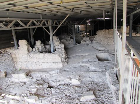 Standing inside King David's palace looking at the excavated walls.