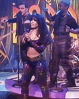 [IMG] Jennifer Lopez performs as Selena while filming the movie