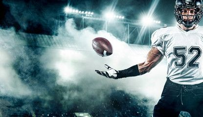 American Football Player Sportsman With Ball In Helmet On Stadium In Action Sport Wallpaper Tea In 2020 Sports Wallpapers American Football Players Football Players