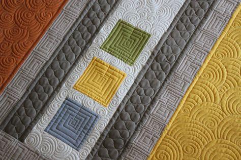 Angela Walters interlocking design, swirls surround, ribbon design
