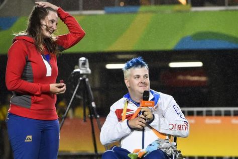 Silver medalist David Drahoninsky of the Czech Republic proposes to his girlfried Lida Fikarova after the medal ceremony for the men's individual archery W1 final atthe Rio 2016 Paralympic Games. © • Getty Images - David Drahoninsky