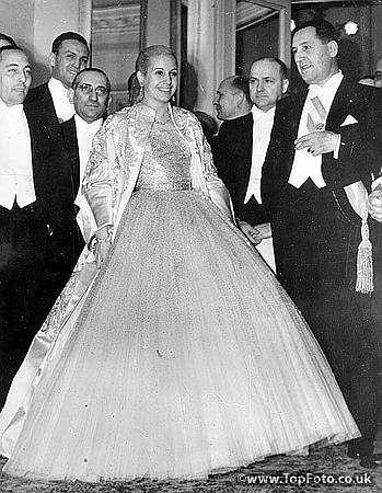 "Eva Peron wearing a glamorous evening gown escorted by her husband, The President of Argentina. Pictured at Argentine's Independence Day ""Gala Night"" at Teatro Colon. Buenos Aires - 30th May 1951"