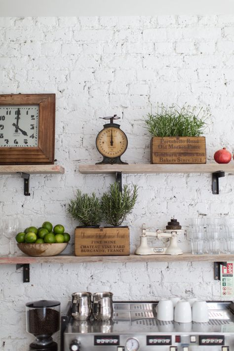 Fixed shelves featuring vintage kitchenware and accesories add the perfect rustic vibe. www.nakedkitchens.com