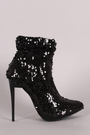 These alluring pointy toe silhouette, slouchy sequin embellished shaft, low hidden platform, and stiletto heel. Finished with cushioned insole, smooth interior