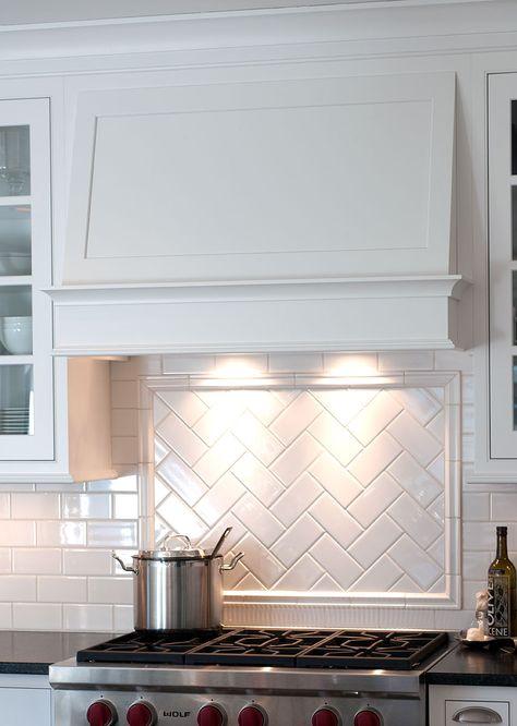 Gorgeous simple hood, and herringbone pattern title backsplash - by Mullet Cabinet