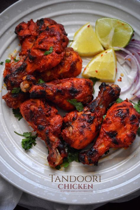 Tandoori Chicken - Savory&SweetFood The classic Indian Tandoori Chicken which is very easy to make at home in the oven and tastes just like the ones you get in the restaurants. I've been making Tandoori Chicken since th… Indian Chicken Recipes, Chicken Drumstick Recipes, Indian Food Recipes, Asian Recipes, Tandoori Chicken Recipe Indian, Pakistani Food Recipes, Authentic Indian Recipes, Chicken Leg Recipes, Ethnic Recipes