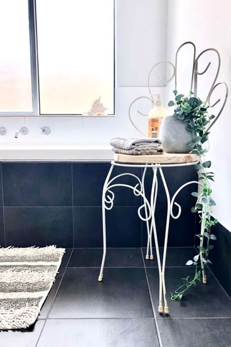 Check out how she took a thrift store metal chair and upcycled it into a bathroom stool for some extra bathroom storage. We love this before and after metal chair makeover idea. Upcycled furniture is a great way to decorate on a budget.