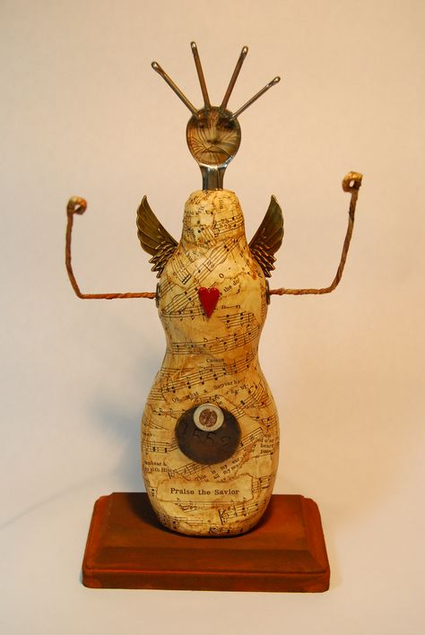 Upcycled Art Angel! We can't decide if its scary or cool? Brought to you by Shoplet.com - everything for your business.