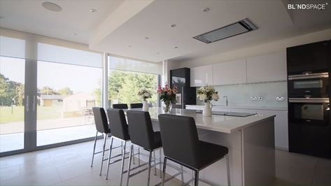 Large sliding glass doors with blinds concealed with Blindspace. With minimal glazing it is important to consider the need for shading, privacy, glare and heat control early in the project to recess it into the ceiling.