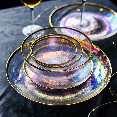 Dine pretty with our Iridescent Gold Tableware that is fit for royalty. Select from our collection of transparent iridescent glass plates and bowls with gold trim. Select all for a luxury collection t
