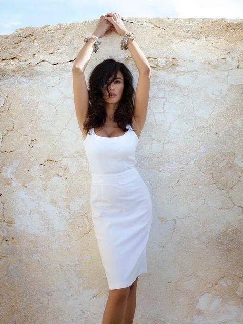 Monica Bellucci white dress arms above head