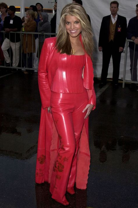 Jessica Simpson in stunning red leather pants top trench coat outfit