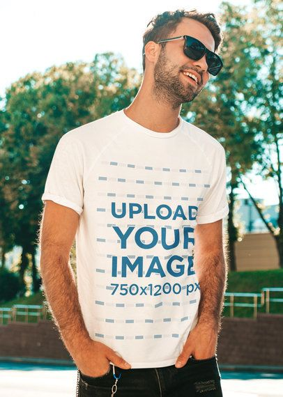 Placeit - T-Shirt Mockup Featuring a Man With Sunglasses Posing at a Park